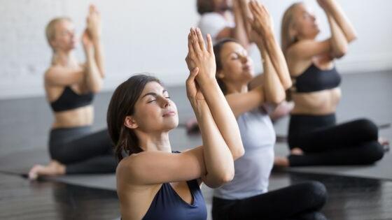 Woman going though fertility doing yoga